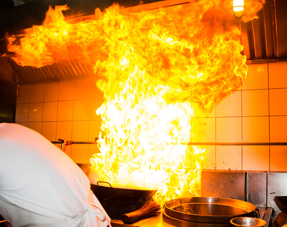 Commercial kitchen hood on fire