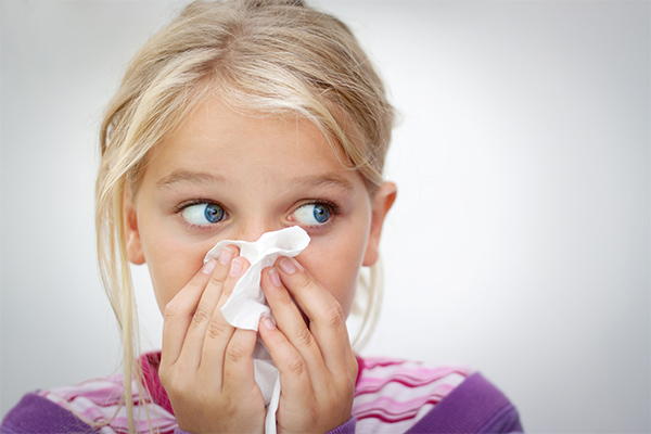 Child blowing nose due to dirty air ducts in the home
