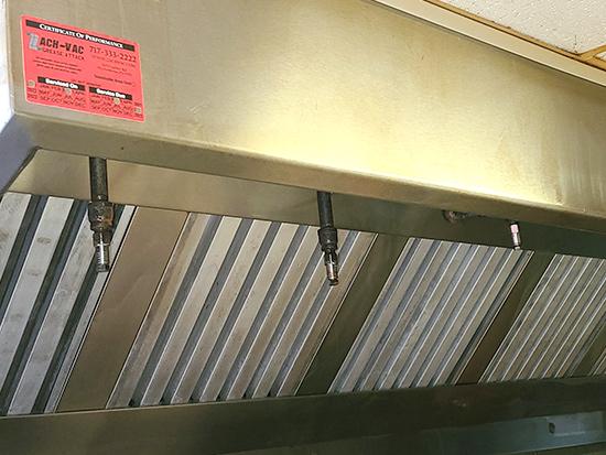 Clean kitchen vent with ZACH-VAC sticker